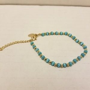 Gold tone and turquoise cats eye bead bracelet